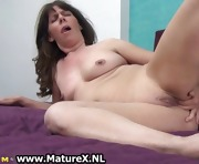 Naughty mature slut fucking her own