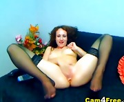 Busty babe oils her tits and pussy
