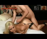 Blonde In Black Bounces On A Cock
